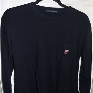 long sleeve navy shirt with flag on pocket